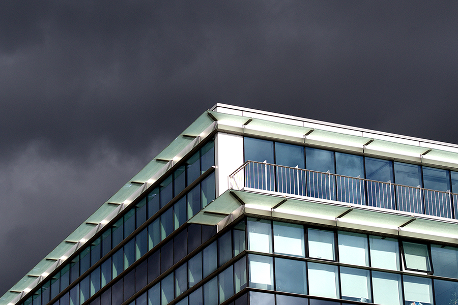 Edge of building with a stormy sky