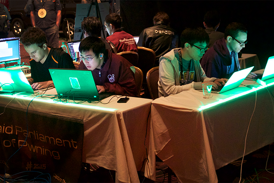 students hacking at DefCon